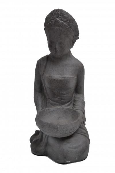 Déesse assise en pierre de lave